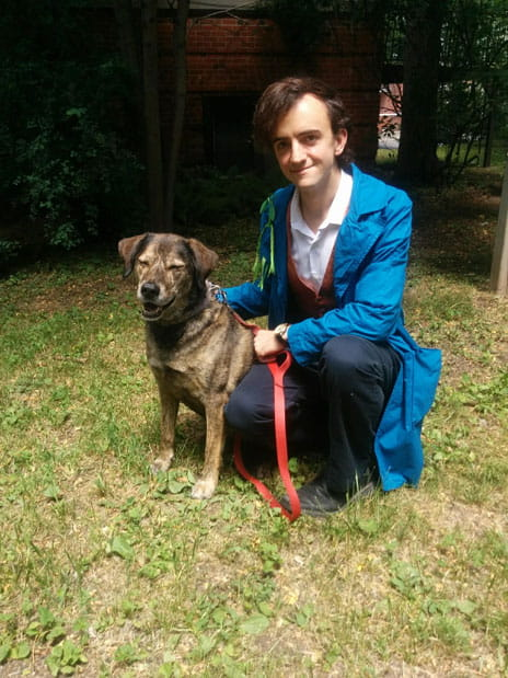 Me, dressed as Newt Scamander from Fantastic Beasts and Where to Find Them, accompanied by a dog named Bo who is a Good Boy